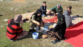 Picnic on mountains. A kurdish family when they are climbing the mountains to have a picnic in a village near qaladiza town, they are drinking tea royalty free stock photography