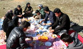 Picnic on mountains. A kurdish family when they are climbing the mountains to have a picnic in a village near qaladiza town, they are having lunch royalty free stock image