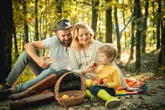 Picnic in nature. Country style family. Meaning of happy family. United with nature. Family day concept. Happy family. With kid boy relaxing while hiking in stock photos