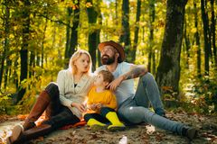 Picnic in nature. United with nature. Family day concept. Happy family with kid boy relaxing while hiking in forest royalty free stock photography
