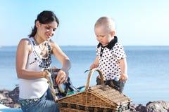 Picnic near sea. Happy mother and son on picnic near sea Stock Photography