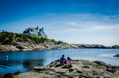 Picnic by the Ocean - Newport RI. Couple share a romantic picnic on the rocks at Ocean Drive in Newport RI Royalty Free Stock Images