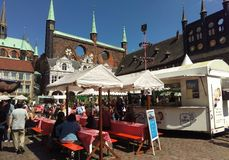 Picnic in old town of Lubek. Germany. Traditional Picnic in LUBECK, GERMANY - Old Hansa cityf Lubeck, is the second largest city in Schleswig-Holstein, northern Royalty Free Stock Photography
