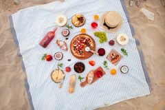 Free Picnic On The Beach At Sunset In The White Plaid, Food And Drink Royalty Free Stock Photo - 109281625
