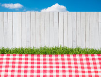 Picnic outdoors. A picnic outdoors at background with white fence Stock Images