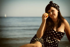 Picnic outdoors woman with orange fruit Stock Photography