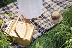Picnic outside. Female feet on a blanket during picnic Royalty Free Stock Image