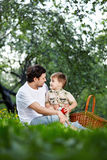 Picnic in park. The daddy with the son in park on picnic Stock Photo