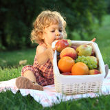 Picnic in park. Child having picnic in summer park. Shallow depth of field Stock Photo