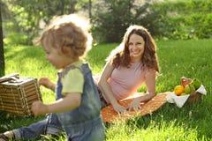 Picnic in park. Happy family having picnic in summer park stock photo