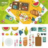 Picnic in the park. Geometric illustartion of summer picnic in the park. Picnic equipment and products on the green lawn, products, camera, radio, phone isolated vector illustration