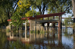 Picnic Pavilion Underwater. Picnic pavilion at Harriet Island in Saint Paul under flood waters with High Bridge in background royalty free stock photo