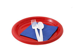 Picnic place setting. Patriotic colors of plate, napkin, spoon, fork and plastic cup Royalty Free Stock Photos