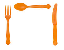 Picnic plastic cutlery - orange colour, knife fork and spoon. Stock Photos