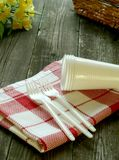Picnic, plastic dishware and napkin on wooden Royalty Free Stock Photography