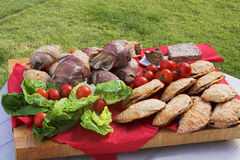 Picnic Platter. With various meat and pastry goodies, tomatoes & lettuce Stock Images