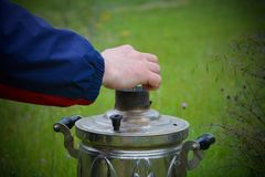 Picnic, preparation for ignition of samovar Royalty Free Stock Images