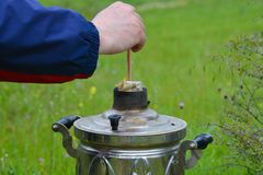 Picnic, preparation for ignition of samovar Royalty Free Stock Photos
