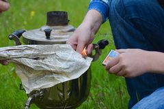 Picnic, preparation for ignition of samovar. Samovar outdoors, Ignition of a samovar, matches Stock Photography