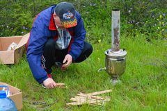 Picnic, preparation for ignition of samovar Stock Photos