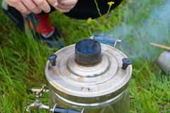 Picnic, preparation for ignition of samovar Royalty Free Stock Image