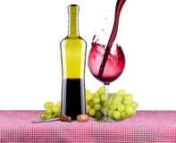 Picnic with red wine and grapes Royalty Free Stock Photo