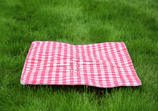 Picnic Retro Tablecloth on Green Grass Stock Photos
