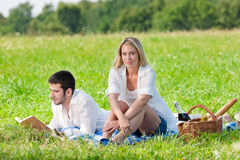 Picnic - Romantic couple read book meadows Royalty Free Stock Image