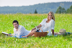 Picnic - Romantic couple read book meadows Stock Photos