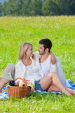 Picnic - Romantic couple in sunny meadows Royalty Free Stock Photography