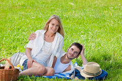 Picnic - Romantic couple in sunny meadows Stock Photography