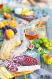 Picnic with rose wine fruits meat and cheese Royalty Free Stock Image