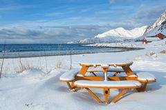 Picnic round table on a snowy beach Royalty Free Stock Photo