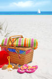 Picnic on sand dune. Pretty picnic basket and beach supplies at seashore Stock Images