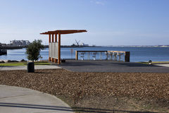 Picnic seats and bench at Koombana North. Bunbury Western Australia a new landscaped development adds a pleasant place to view the harbour and yachts on a sunny stock photography