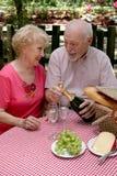 Picnic Seniors - Opening Wine Stock Image