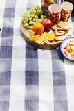 Picnic setting with fresh fruit and snacks Stock Photos