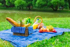 Picnic setting with white wine, pears, fruits, Stock Image