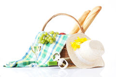 Picnic setting with wine, fruits and summer hat isolated on white Stock Photo