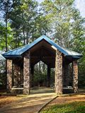 Picnic Shelter in a Park The Woodlands TX. The Woodlands, TX USA  -  03/14/2019  -  Picnic Shelter in a Park The Woodlands TX with Blue Roof stock image