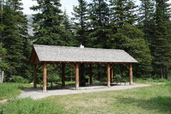 A picnic shelter in the rocky mountains. Stock Image