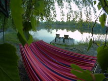 Picnic site. lake, picnic, nature, outdoor. Rest on the lake, a hammock and chairs on the stage royalty free stock photo
