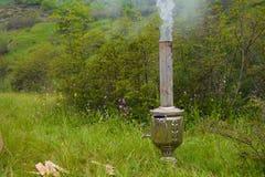 Picnic, smoking samovar pipe Stock Photos