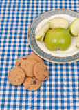 Picnic Snacking. Picnic Cloth with Cookies and Apples Royalty Free Stock Image