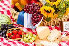 Picnic. Summer picnic with a basket of food in the park Royalty Free Stock Photography