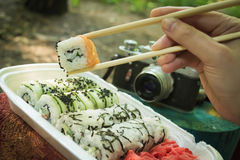 Picnic. Sushi outdoors on a summer day. Day off in the park royalty free stock photo