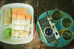 Picnic. Sushi outdoors on a summer day. Day off in the park royalty free stock photography