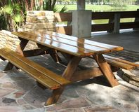 Picnic Table. The picnic tables at Lake Seminole Park, Seminole Florida are beautifully finished. They are well constructed and have a mirror finish Stock Image