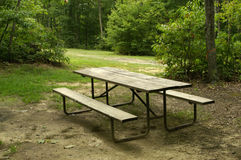 Picnic table. A wooden picnic table in a campgtound Royalty Free Stock Photo