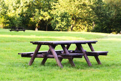 Picnic table. Wooden picnic table in a park Royalty Free Stock Image